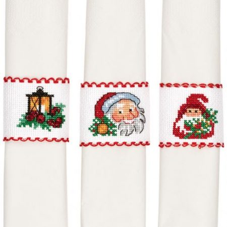 Borduurpakket. Merk: Permin. Aida. Servetring. Kerstman of lantaarn.