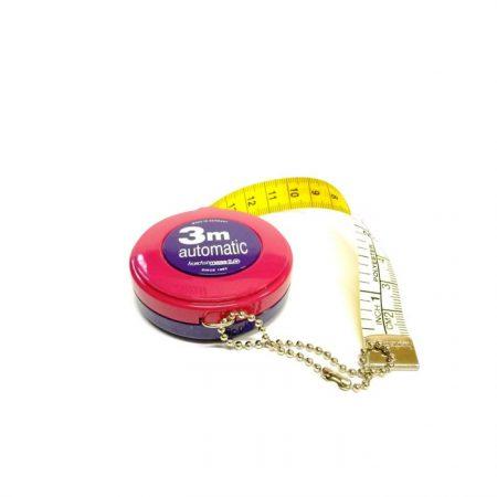 Hoechst Rolcentimeterband inches en centimeters. Centimeter- en inches